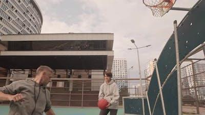 Amateurs Warming up on Basketball Court