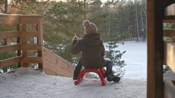 Thumbnail for Kid Sliding Downhill on Winter Vacation