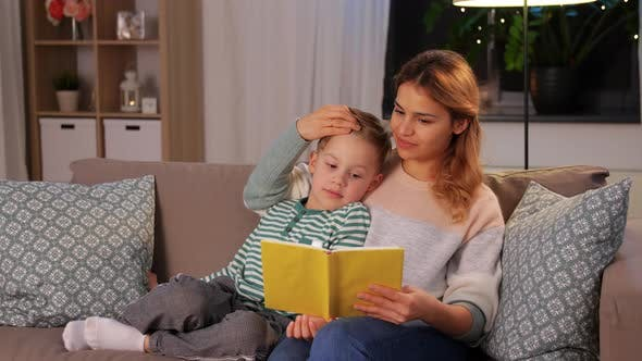 Thumbnail for Happy Mother and Son Reading Book Sofa at Home