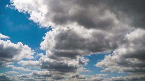 Clouds Move Smoothly in the Blue Sky. Timelapse. Cloud Space.