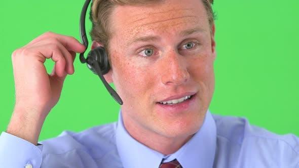 businessman talking on headset on greenscreen