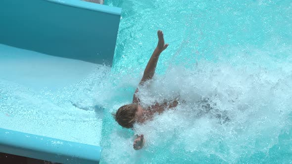 Thumbnail for Boy going down waterslide in super slow motion
