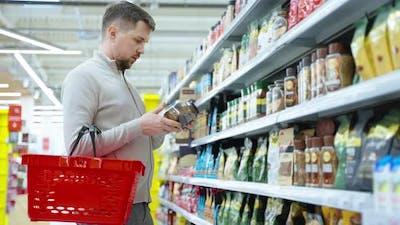 Coffee Lover is Choosing Instant Coffee in Supermarket Man is Buying Soluble Coffee