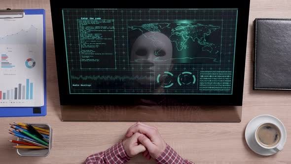 Thumbnail for A Reflection of a Hacker in White Mask Sits in Front of a Monitor and Analyzes Data