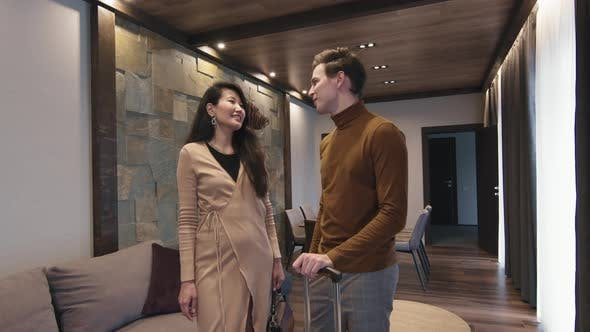 Smart Couple Talking In Hotel Room