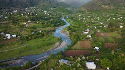 River And Green Village In The Valley