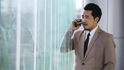 young business man talking on mobile phone