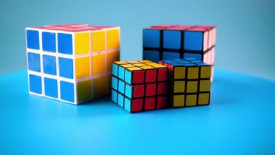 Conceptual large and small rubik's cube rotate