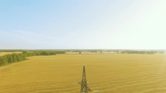 Thumbnail for Flight Near High Voltage Electricity Tower and Power Lines at Green and Yellow