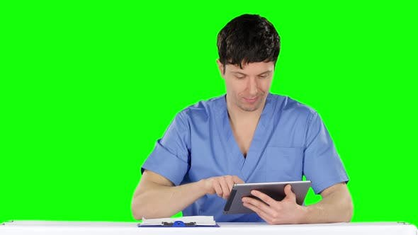 Thumbnail for Doctor Uses a Tablet and Shows Thumb. Green Screen