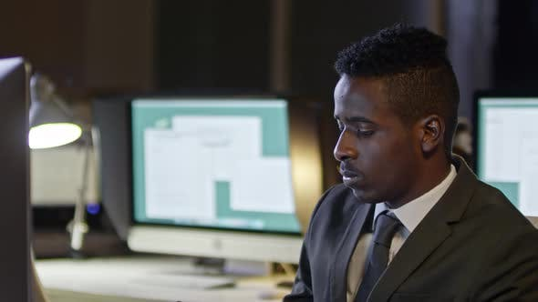 Thumbnail for African Businessman Typing on Computer