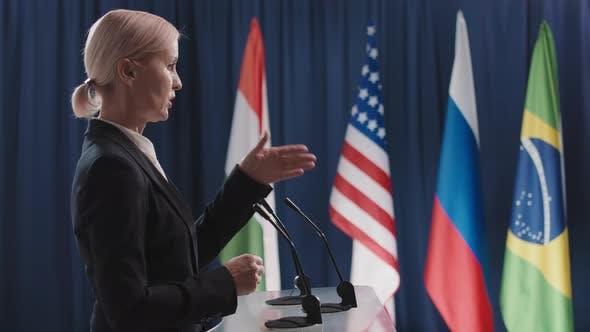Serious Female Politician Speaking