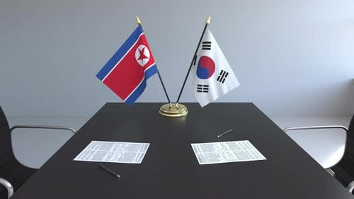 Flags of North Korea and South Korea on the Table