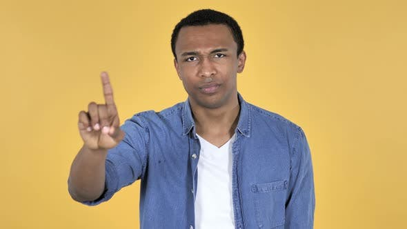 Thumbnail for Young African Man Waving Finger To Refuse, Yellow Background