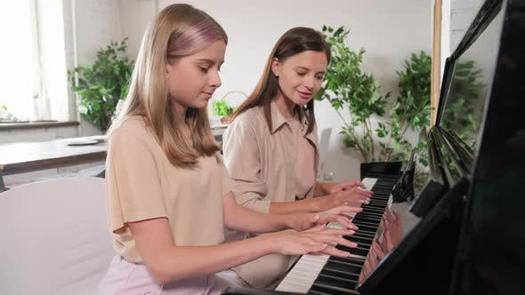 Woman Giving Piano Lessons