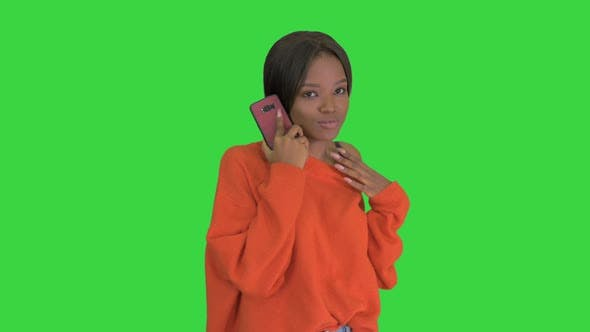 Thumbnail for Pretty African American Woman in Bright Jumper Talking on the Phone and Gesturing Emotionally on a