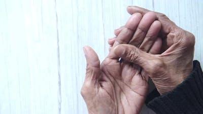 Elderly Woman Suffering Pain Ion Fingers