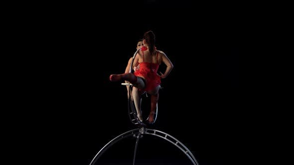 Thumbnail for Two Gymnasts Performs a Trick on the Aerial Hoop Metal Construction