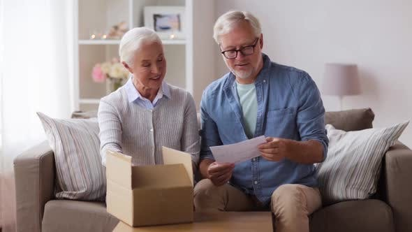 Thumbnail for Senior Couple with Parcel and Delivery Note