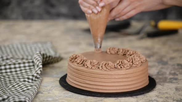 Thumbnail for Baker Decorated Chocolate Cake With Cream.