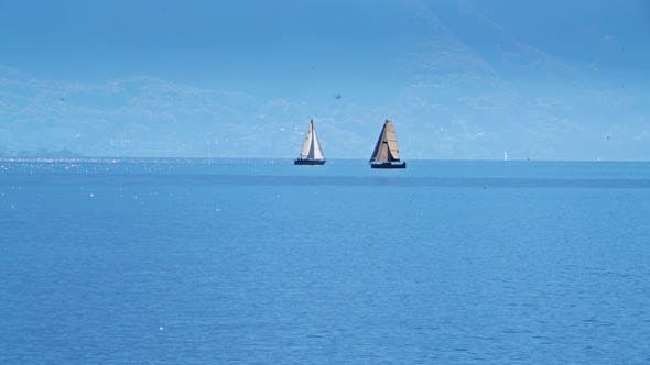 Thumbnail for Small Sailing Yacht on the Lake Geneva and the Alps Mountains Switzerland