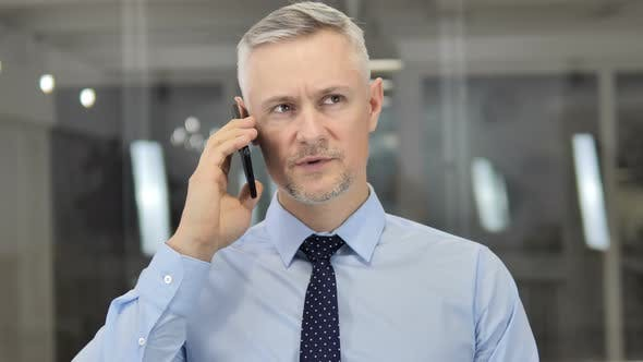 Thumbnail for Grey Hair Businessman Negotiating with Customer During Phone Talk
