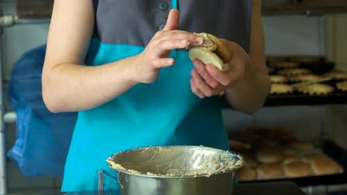 Woman Applying Cream on Crunchy Cookie