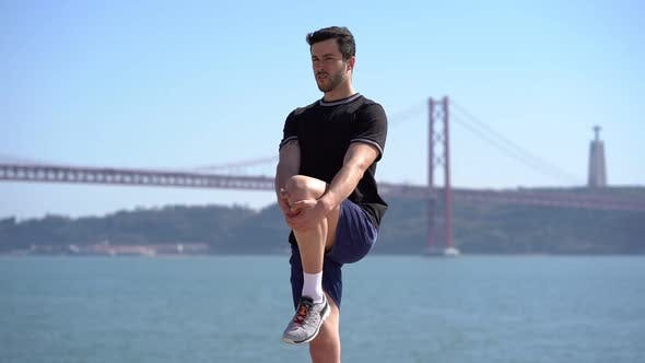 Thumbnail for Athletic Man Stretching Bein am Riverside