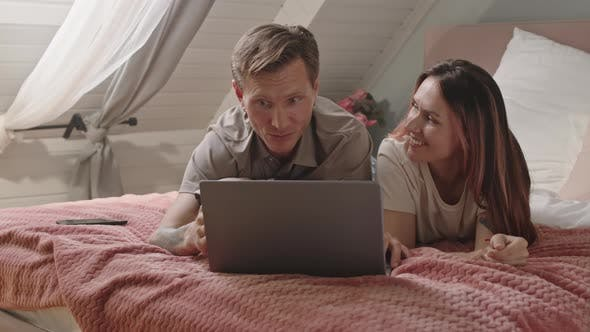Couple Chilling with Laptop in Morning