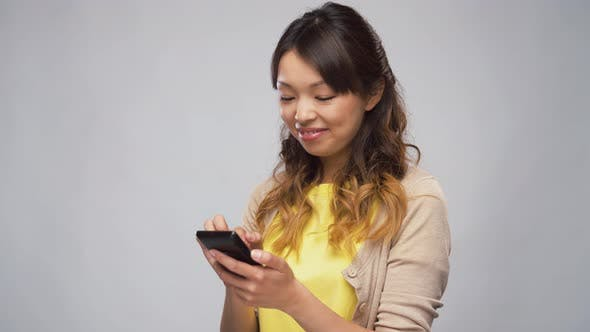 Cover Image for Asian Woman Using Smartphone