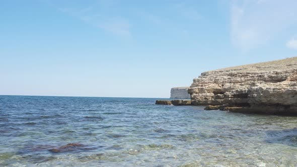 Seascape on a Sunny Clear Day and a Rocky Coastline.