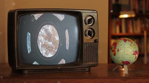 The Cupola (ISS module) and Earth as Seen on a Vintage TV near a Terrestrial Globe.
