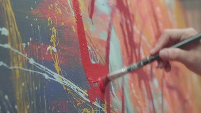 Holding Paint Brush And Drawing Painting With Red Paint