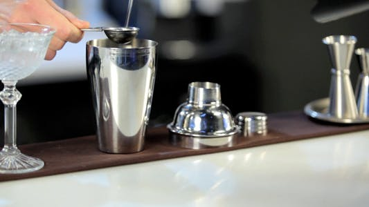 Thumbnail for Bartender Pouring Liqueur into a Shaker