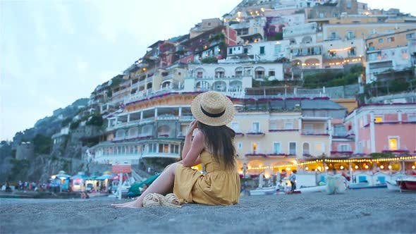 Thumbnail for Summer Holiday in Italy. Young Woman in Positano Village on the Background, Amalfi Coast, Italy