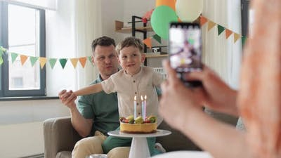 Family with Birthday Cake Photographing at Home