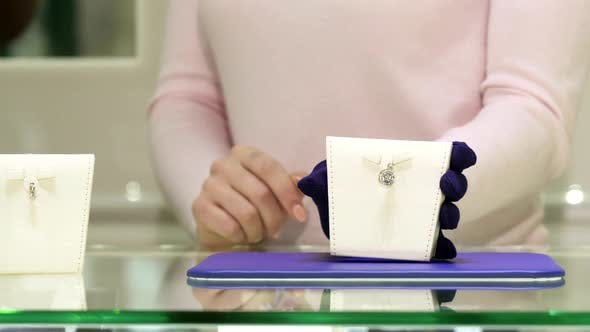 Thumbnail for Woman Shows Different Jewelry Goods at the Shop