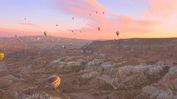 Aerial Drone View Pink Dawn in Cappadocia in the Rose Valley with Views of the Hills and Colorful