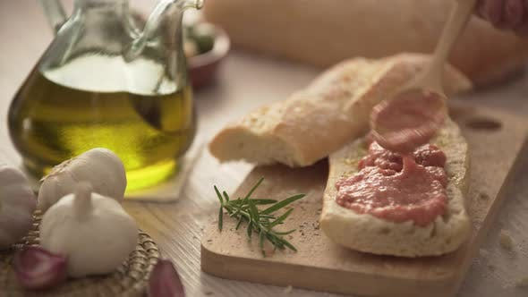 Rustic bread, tomato and olive oil ready to make toasts