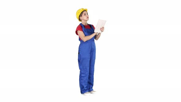 Thumbnail for Female Engineer in Yellow Safety Helmet Is Looking To Tablet Computer While Checking for