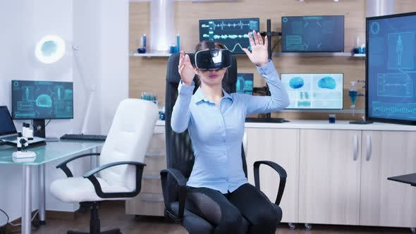 Thumbnail for Female Physician Using Virtual Reality Goggles in a Futuristic Clinic