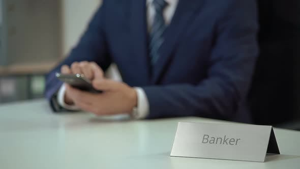 Male Banker Typing Message on Smartphone, Scrolling and Zooming Pages on Screen