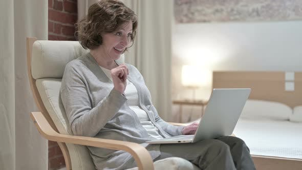 Thumbnail for Old Woman Doing Video Chat on Laptop on Sofa