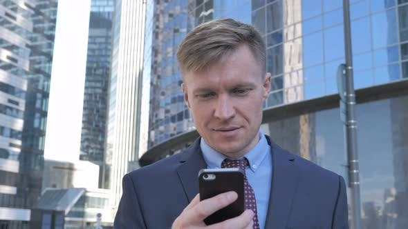 Thumbnail for Businessman Using Smartphone while Walking to Office