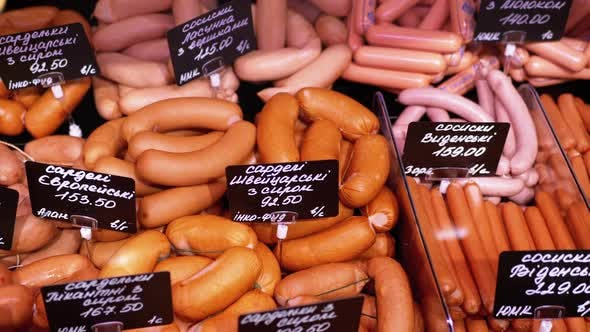 Thumbnail for Sausages with Price Tags on the Showcase in the Store. Meats Sale in Butcher Shop