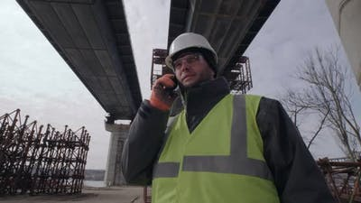 Male Contractor Speaking on Smartphone