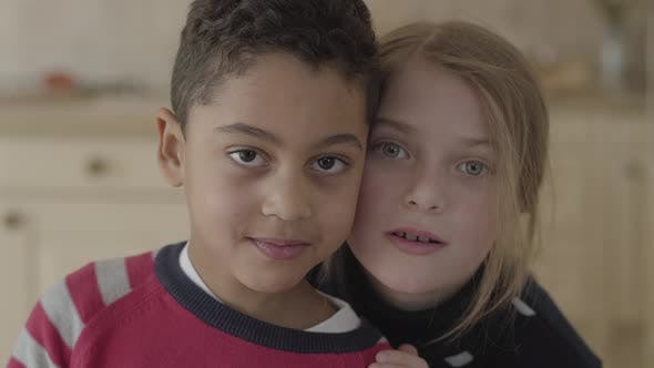 Thumbnail for Portrait of Handsome African American Boy and Pretty Blond Caucasian Girl Having Sitting Together in
