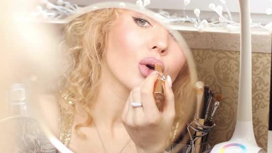 Thumbnail for Female Adult Applying Pink Lipstick on Full Lips