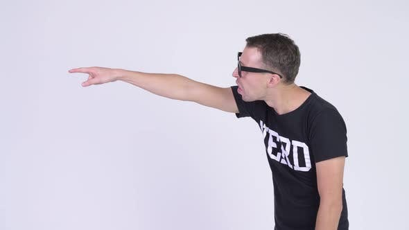 Cover Image for Profile View of Angry Nerd Man Talking and Showing Middle Finger