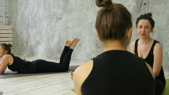 Thumbnail for Young Athletic Women Friends Sitting on Yoga Mats, Talking After Yoga Class